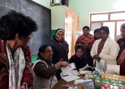 SR DR ALPHY CONDUCTING CAMP ON CANCER SCREENING IN WOMEN